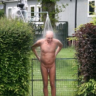 Naturist man showering